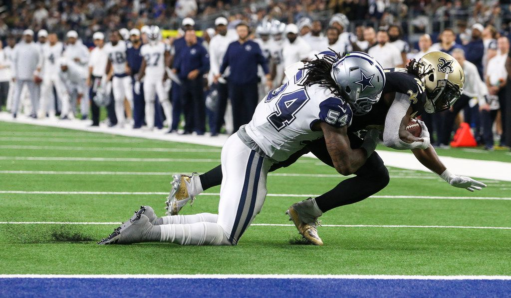 Dallas Cowboys middle linebacker Jaylon Smith (54) stops New Orleans Saints running back Alvin Kamara (41) near the end zone during the first half of a matchup between the Dallas Cowboys and the New Orleans Saints on Thursday, Nov. 29, 2018 at AT&T Stadium in Arlington, Texas. (Ryan Michalesko/The Dallas Morning News)