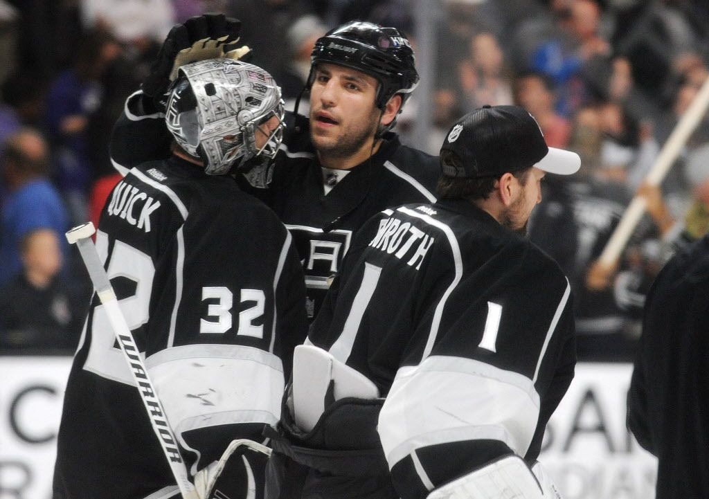 April 7, 2016; Los Angeles, CA, USA; Los Angeles Kings goalie Jonathan Quick (32) and left wing Milan Lucic (17) celebrate the 2-1 victory against Anaheim Ducks at Staples Center. Mandatory Credit: Gary A. Vasquez-USA TODAY Sports