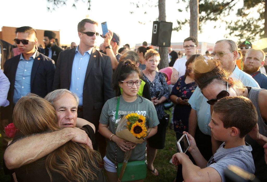 Texas governor Greg Abbott hugs a student at the vigil al in Santa Fe, Texas.