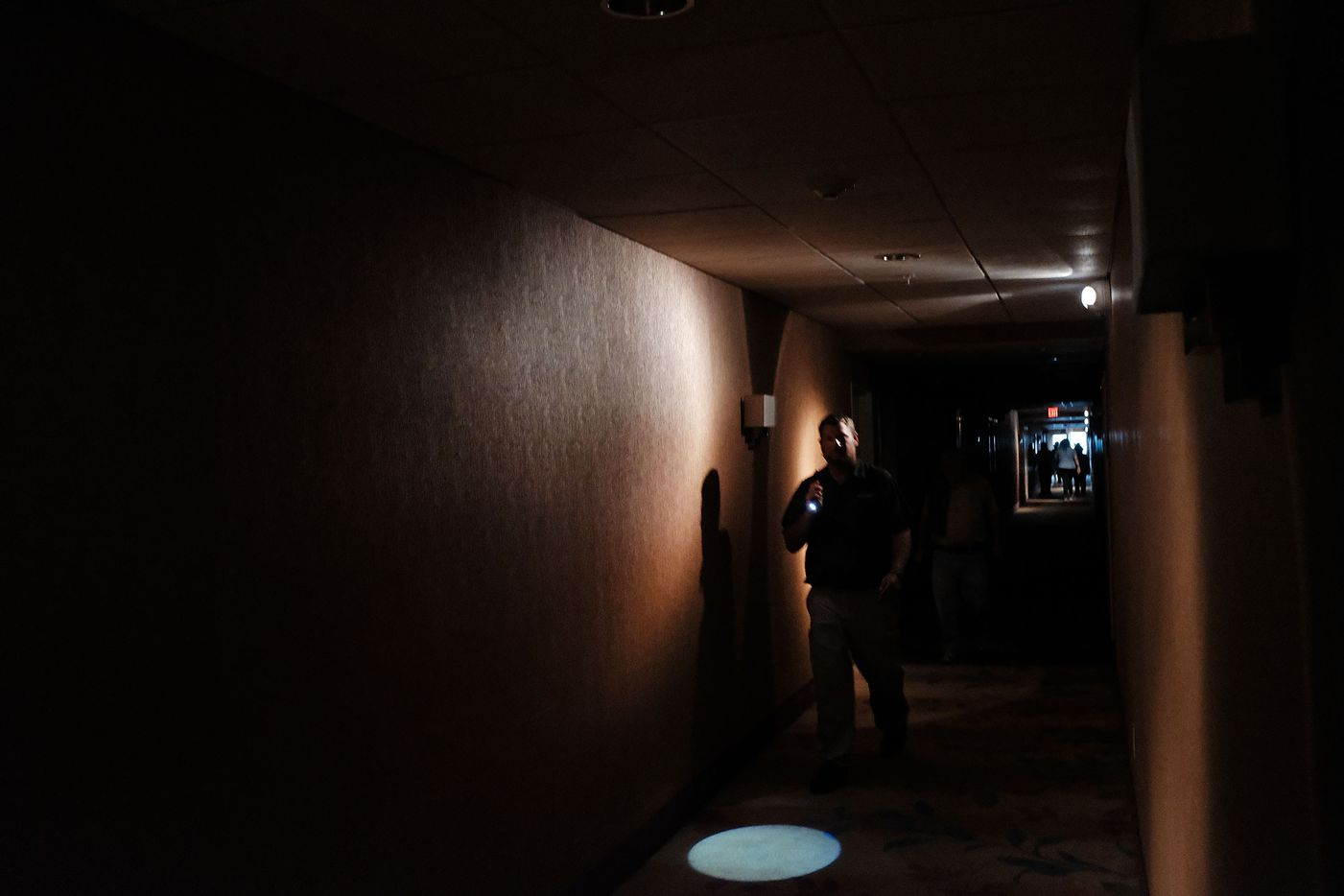 Hotel guests walk through dark hallways after the electricity was cut at a hotel as Hurricane Irma arrives into southwest Florida on September 10, 2017 in Fort Myers, Florida. With businesses closed, thousands in shelters and a mandatory evacuation in coastal communities, the Fort Myers area is preparing for a possibly catastrophic storm.