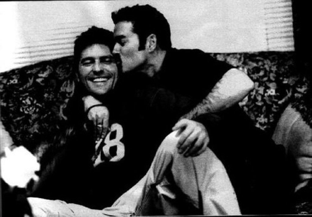 British pop superstar George Michael (right) kisses his Dallas partner Kenny Goss in an undated photograph from Goss' private collection