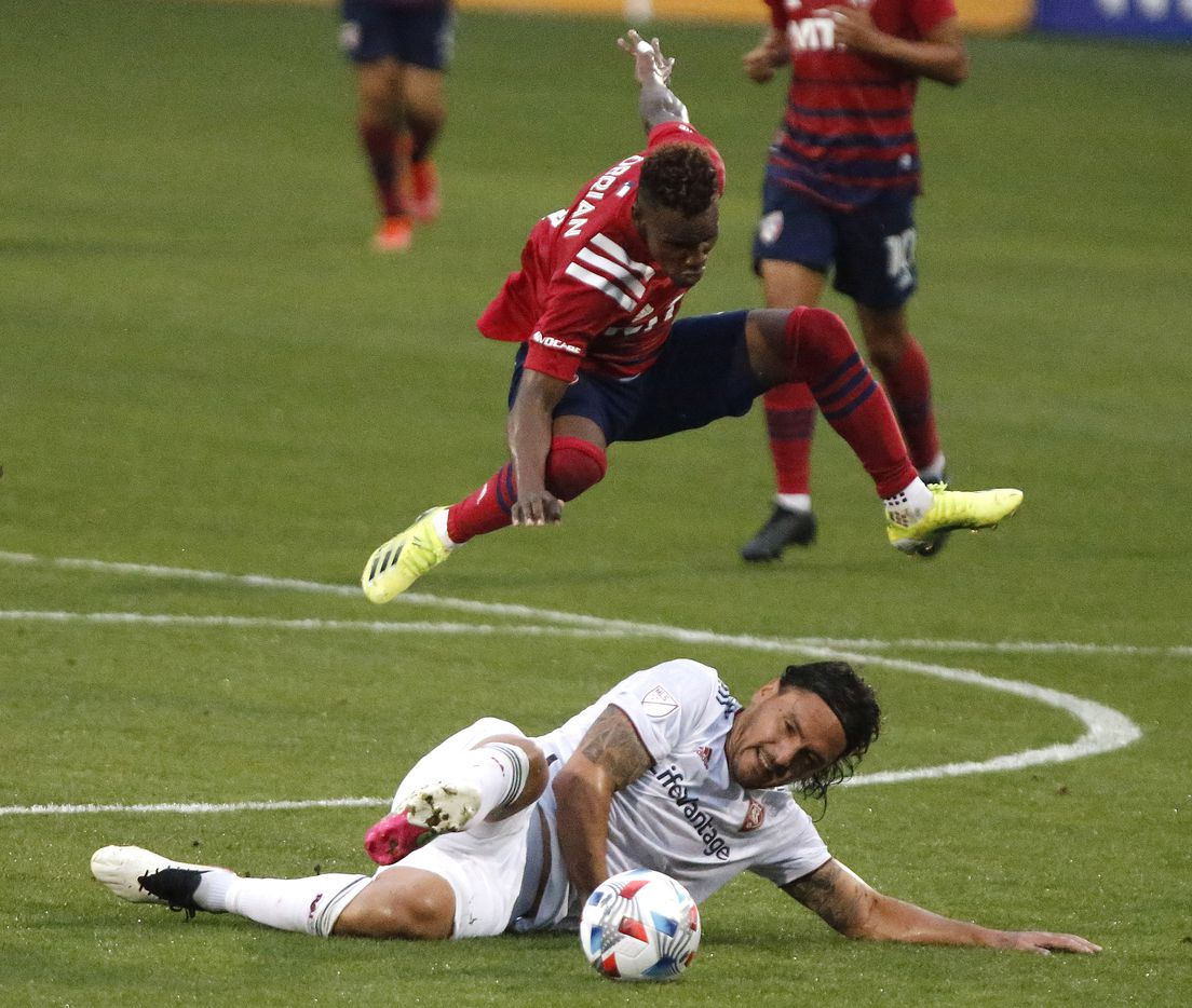 FC Dallas forward Jader Obrian (7) leaps over Real Salt Lake defender Marcelo Silva (30) during the first half as FC Dallas hosted Real Salt Lake at Toyota Stadium in Frisco on Saturday, May 22, 2021. (Stewart F. House/Special Contributor)