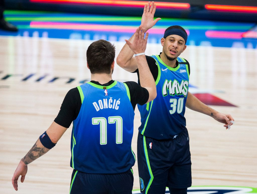 Dallas Mavericks forward Luka Doncic (77) high-fives guard Seth Curry (30) after a 120-112 win over the Portland Trail Blazers on Friday, January 17, 2020 at American Airlines Center in Dallas. (Ashley Landis/The Dallas Morning News)