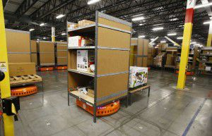 A pick-mod by Amazon robotics move around shelves a the Amazon.com fulfillment center in Coppell, Texas August 12, 2015. (Nathan Hunsinger/The Dallas Morning News)