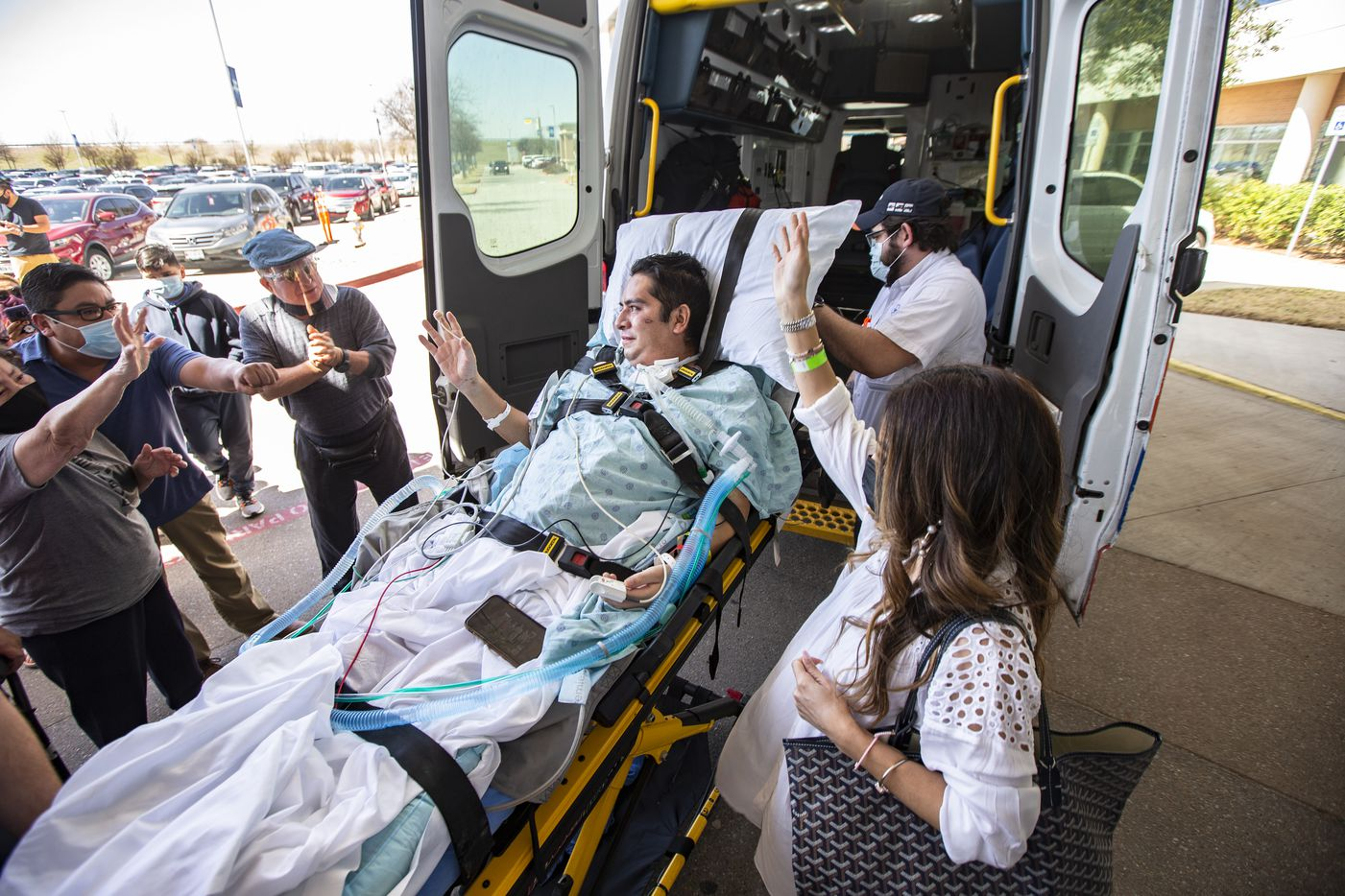 Hugo Miranda and his wife Betty wave to family and friends as he is released from Methodist Richardson Medical Center, after two and half months of battling COVID-19, Monday, March 15, 2021. Miranda will spend time in a rehab facility before going home.