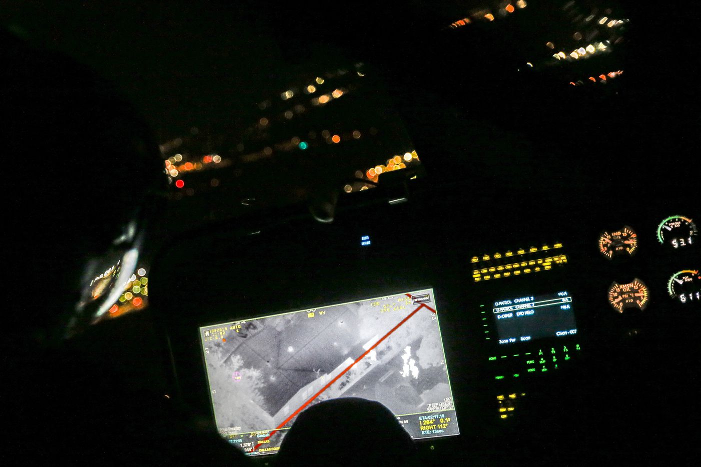 Police officers figures can be seen through an infrared camera aboard the Dallas Police Helicopter Unit, otherwise known as DPD Air One, as the officers search for a hiding suspect on Wednesday, Nov. 6, 2019.