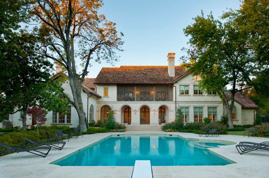 The home's backyard is built for entertainment, with a pool, tennis court and four-car garage.