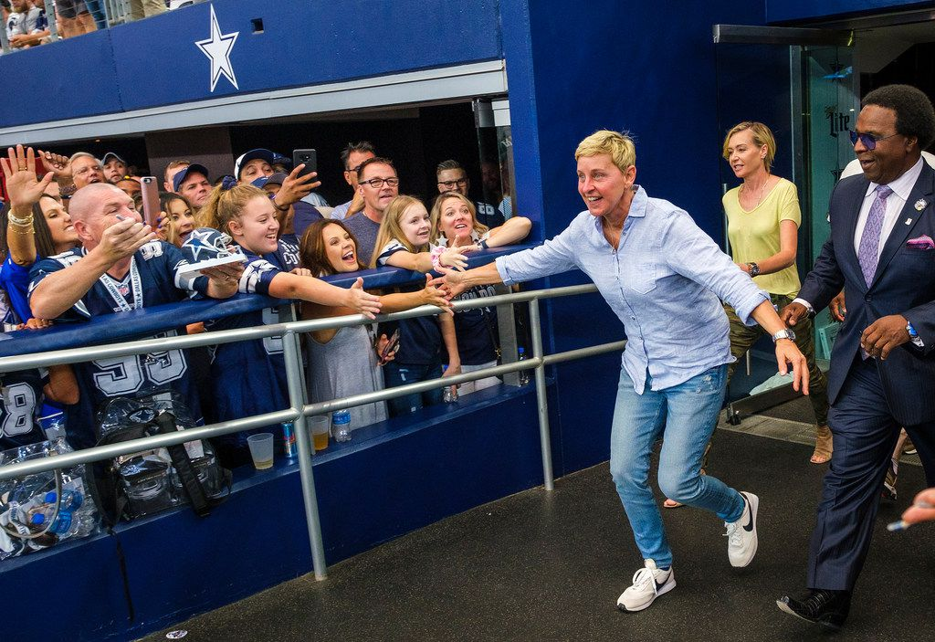 Ellen DeGeneres high fives fans before an NFL football game between the Dallas Cowboys and the Green Bay Packers at AT&T Stadium on Sunday, Oct. 6, 2019, in Arlington.