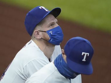 Texas Rangers catcher Sam Huff looks out over the stadium while talking with first base coach Corey Ragsdale in the dugout before a game against the Los Angeles Angels at Globe Life Field on Thursday, Sept. 10, 2020. Huff received his first big league call up before the game. (Smiley N. Pool/The Dallas Morning News)