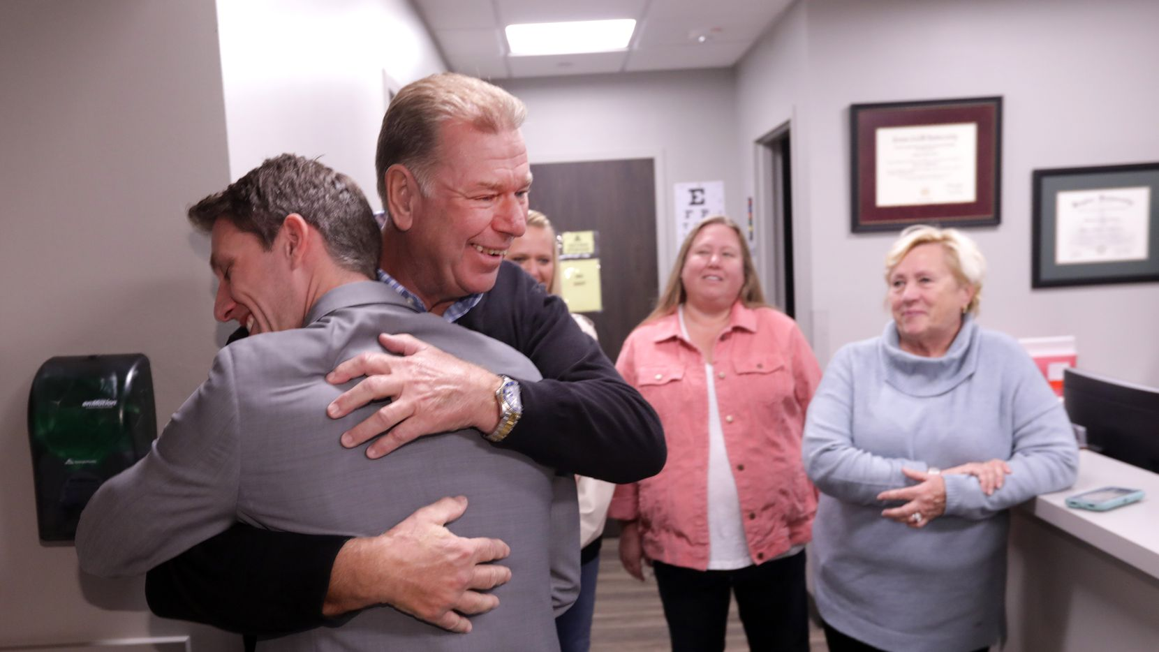 Dr. Andrew Parker, left, and Dennis Bennett embrace after meeting at Allen Orthopedics and Sports Medicine in Allen, TX, on Nov. 13, 2019. (Jason Janik/Special Contributor)