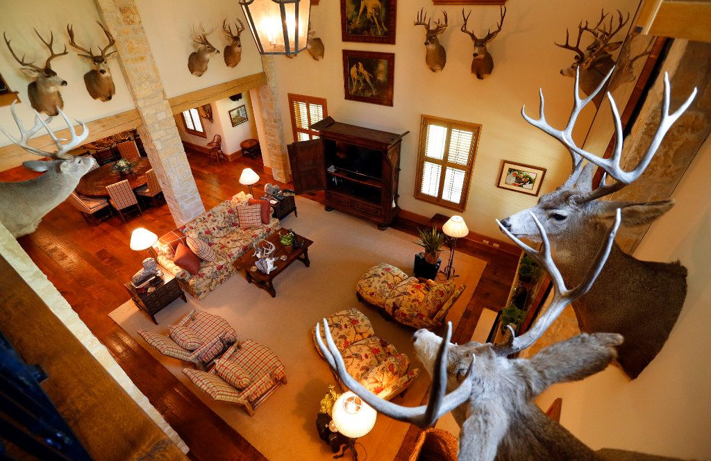 Deer mounts line the main living area of a The Family House on billionaire T. Boone Pickens' Mesa Vista Ranch in the Texas Panhandle. (Tom Fox/Staff Photographer)
