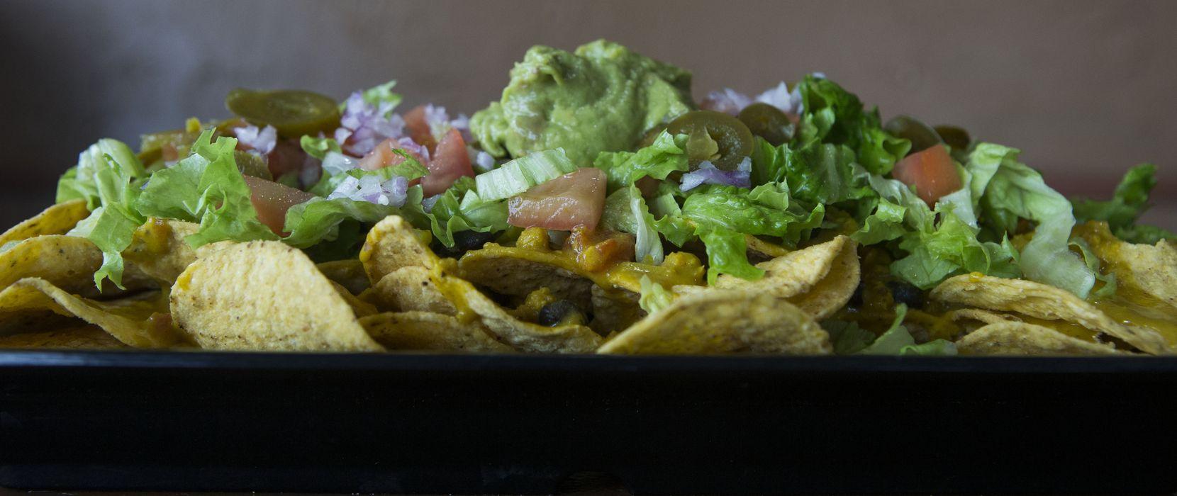 Loaded vegan nachos at Sankofa Kitchen on Friday, July 7, 2017.(Ryan Michalesko/The Dallas Morning News)