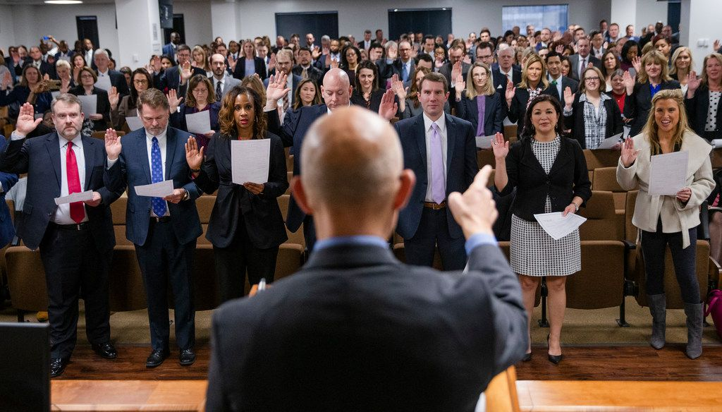 District Attorney John Creuzot administers the oath of office to his prosecutors during a swearing-in ceremony Tuesday at the Frank Crowley Courts Building in Dallas.