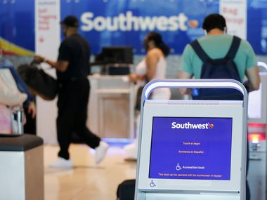 Southwest Airlines passengers prepared to check their baggage at Dallas Love Field Airport on July 20.