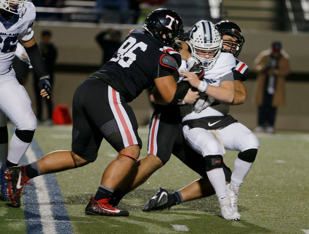 Trinity's Poukesi Vakauta (96) and Tonga Lolohea (54) tackle Richland quarterback Cole Benson (10) during the first half of their high school football game on Friday Nov. 8, 2019. (Michael Ainsworth/Special Contributor)
