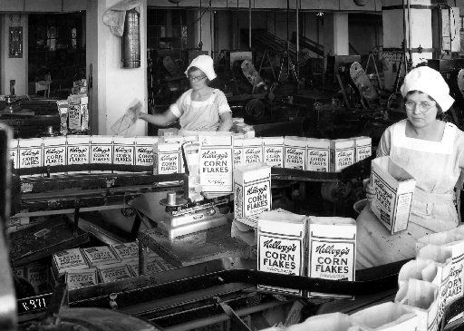 Kellogg Co. factory employees pack Corn Flakes packages in Battle Creek, Mich., in 1922.