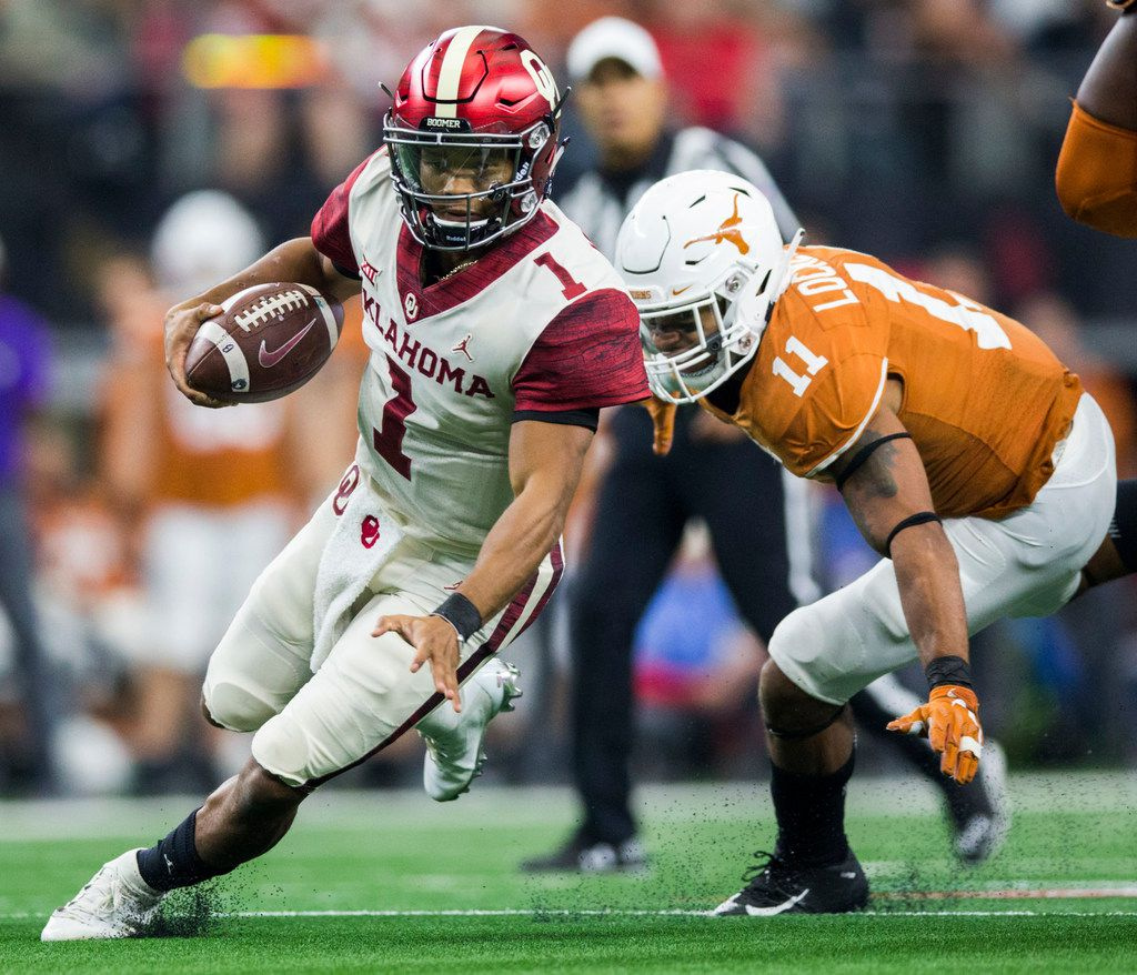 Oklahoma Sooners quarterback Kyler Murray (1) gets away from Texas Longhorns defensive back P.J. Locke III (11) during the fourth quarter of the Big 12 Championship football game between the Texas Longhorns and the Oklahoma Sooners on Saturday, December 1, 2018 at AT&T Stadium in Arlington, Texas. (Ashley Landis/The Dallas Morning News)