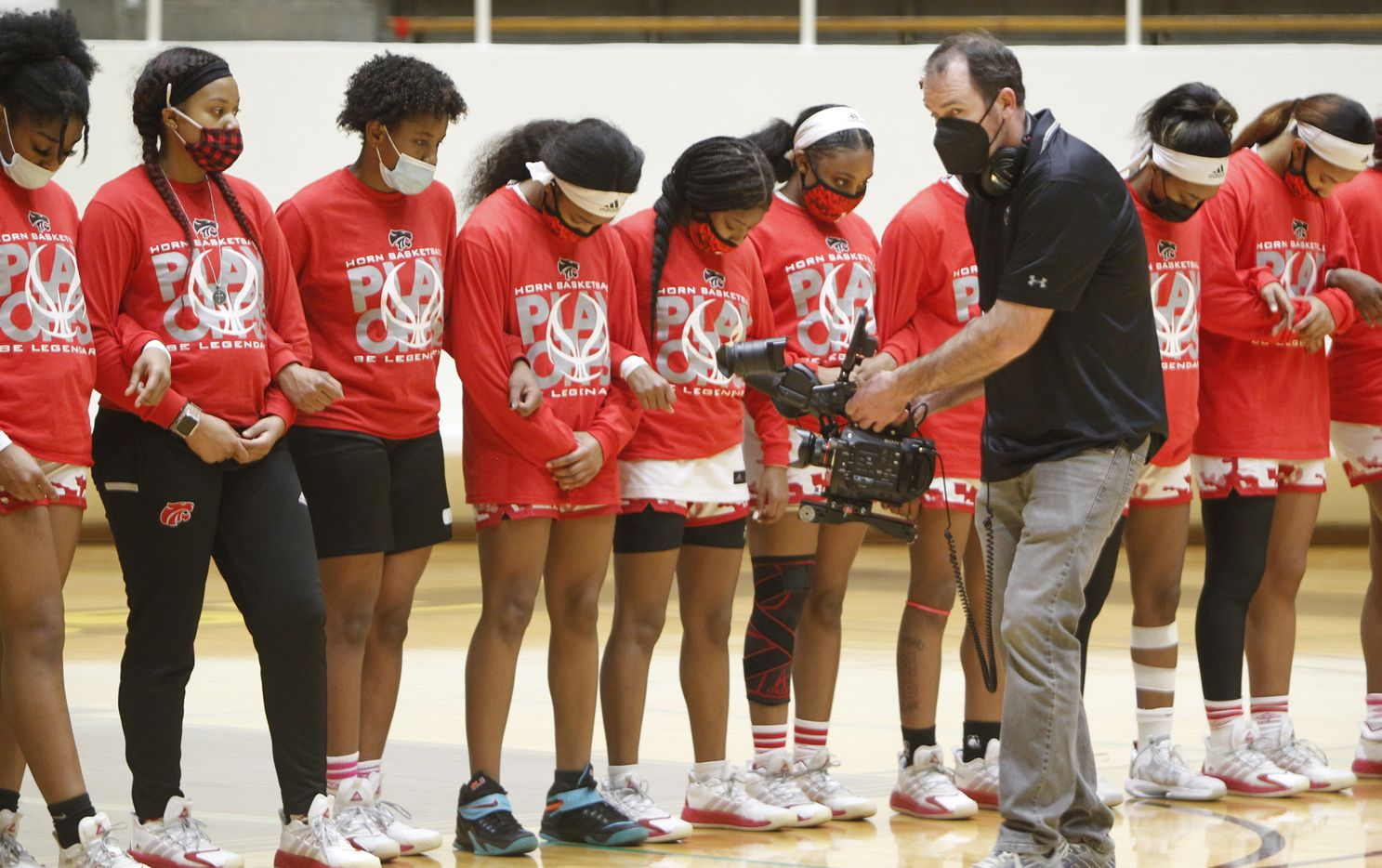 Members of the Mesquite Horn varsity girls basketball team pause for the playing of the national anthem prior to the start of their game against Duncanville. The two teams played their Class 6A area-round playoff basketball game at Loos Field House in Addison on February 23, 2021. (Steve Hamm/ Special Contributor)