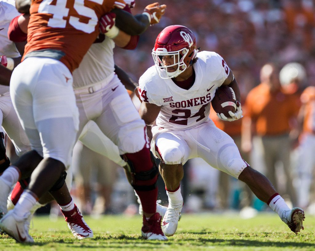 Oklahoma Sooners running back Rodney Anderson (24) runs the ball during the second quarter of the AT&T Red River Showdown college football game between the University of Texas and Oklahoma University on Saturday, October 14, 2017 at the Cotton Bowl in Fair Park in Dallas. (Ashley Landis/The Dallas Morning News)