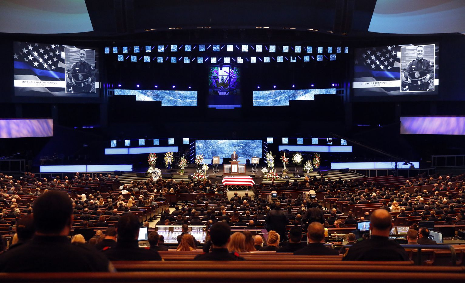 Police officers from departments across the Metroplex attend the funeral service for Dallas Police officer Mitchell Penton at Prestonwood Baptist Church in Plano, Monday, February 22, 2021. Penton was killed Saturday, Feb. 13, 2021, in a crash involving a drunk driving suspect.(Tom Fox/The Dallas Morning News)