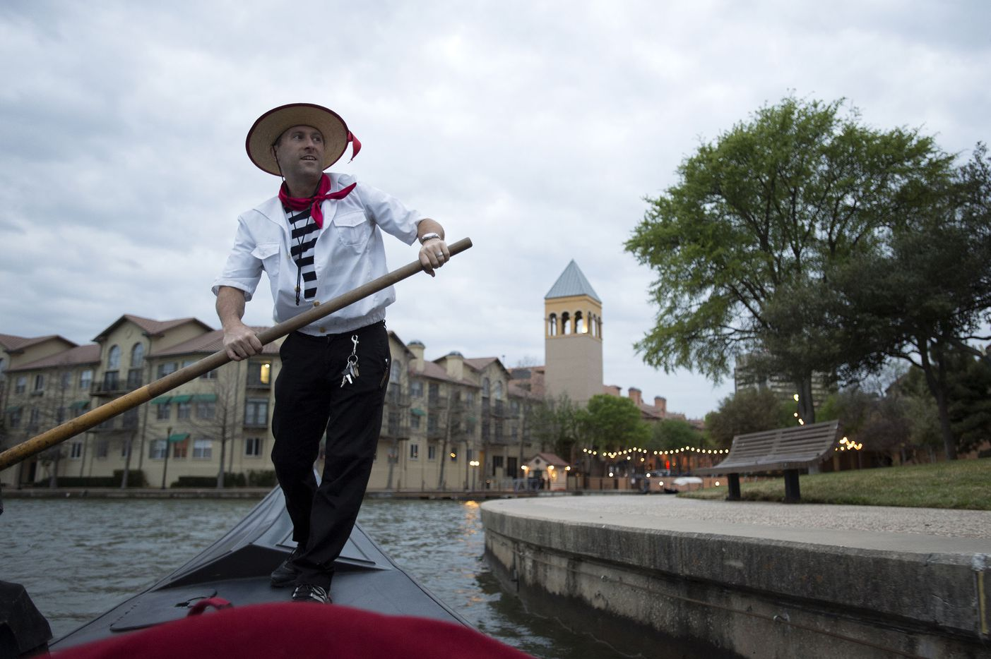 Greg Mohr, chief gondolier for Gondola Adventures, rows his gondola on Las Colinas' Lake Carolyn in March, 2013.