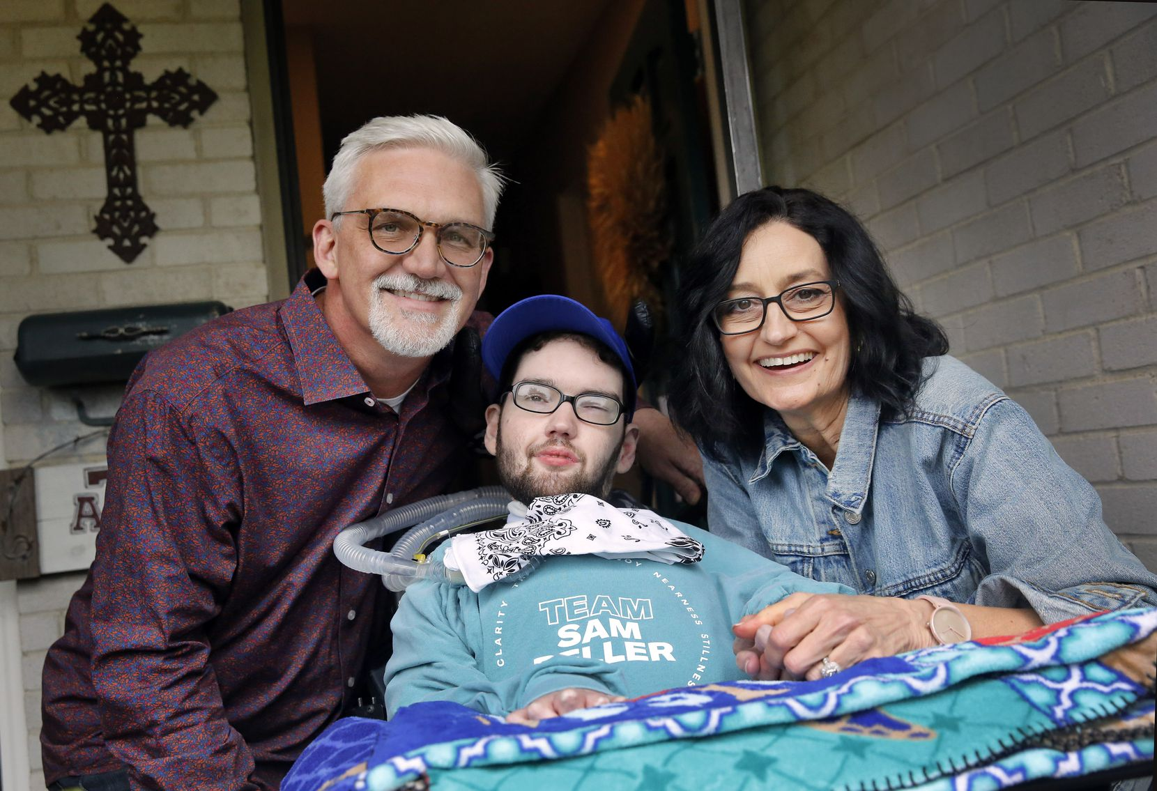Sam Beller, with parents Kelly and David, was 7 years old when he first required a ventilator to breathe. Now 20 years later, Sam lives a healthy life with a home ventilator, 24/7 nursing care and physical therapy.