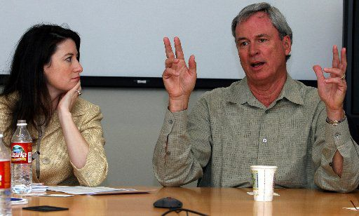 At left, Jennifer Michalski of Sevin Rosen Funds listens as Berry Cash of InterWest Partners makes a point during a 2005 roundtable discussion of venture capital funding executives.