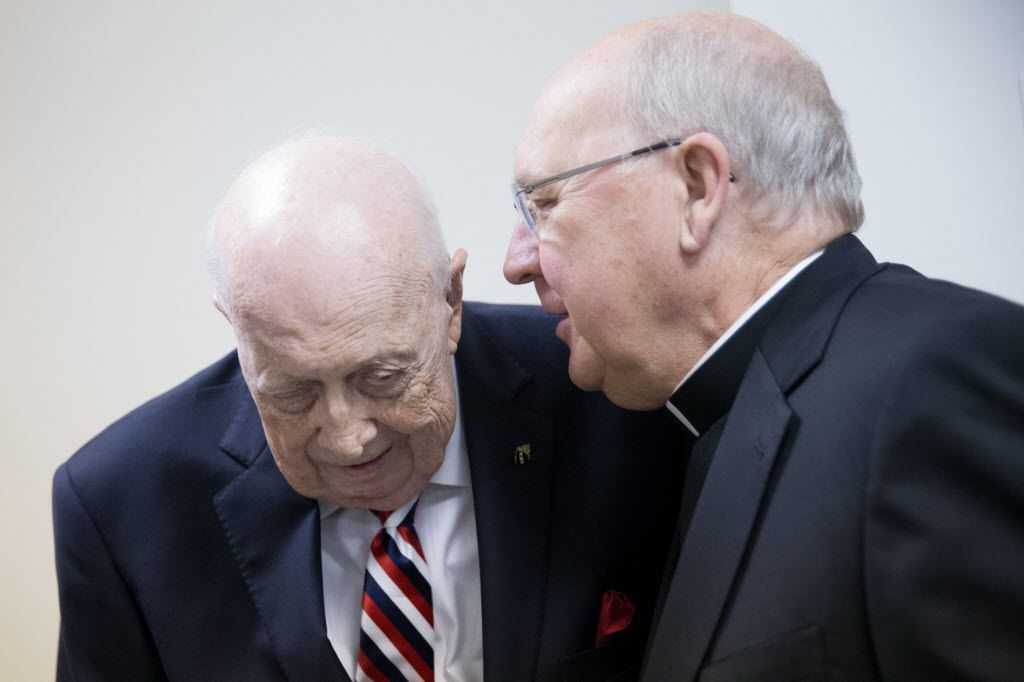 Bishop Kevin J. Farrell speaks to Steven Landregan during Landregan and Tony Ramirez's retirement party at the Diocese of Dallas Pastoral Center on June 23, 2016.