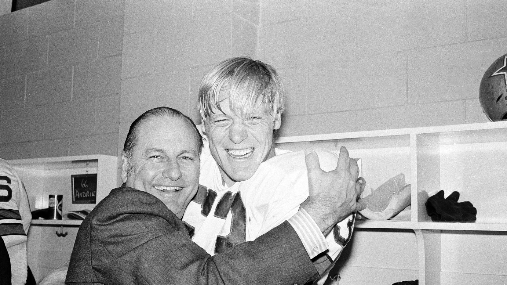 Texas E. Schramm, president and general manager of the Dallas Cowboys, gives defensive end Larry Cole a hearty embrace for this defensive play against the Detroit Lions in the Cotton Bowl in Dallas, Dec. 27, 1970. Cole was among the first of the Cowboys Doomsday Defense to trap Detroit quarterback Greg Landry in the end zone for a safety, in the NFC playoff game, won by Dallas, 5-0.
