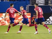 Players celebrate FC Dallas midfielder Ryan Hollingshead (12) goal during the first half of a match between FC Dallas and Los Angeles FC on Wednesday, Oct. 20, 2021, at  Toyota Stadium in Frisco. (Juan Figueroa/The Dallas Morning News)