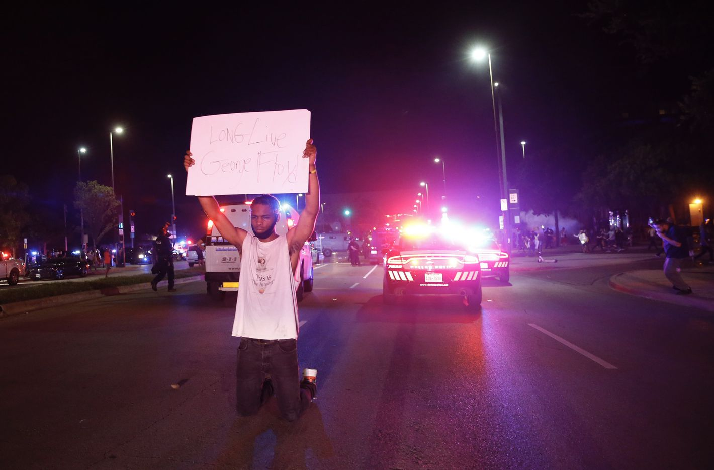 Jordan Spotser Of Dallas holds up a sign as protesters rally during a demonstration against police brutality in downtown Dallas, on Friday, May 29, 2020.