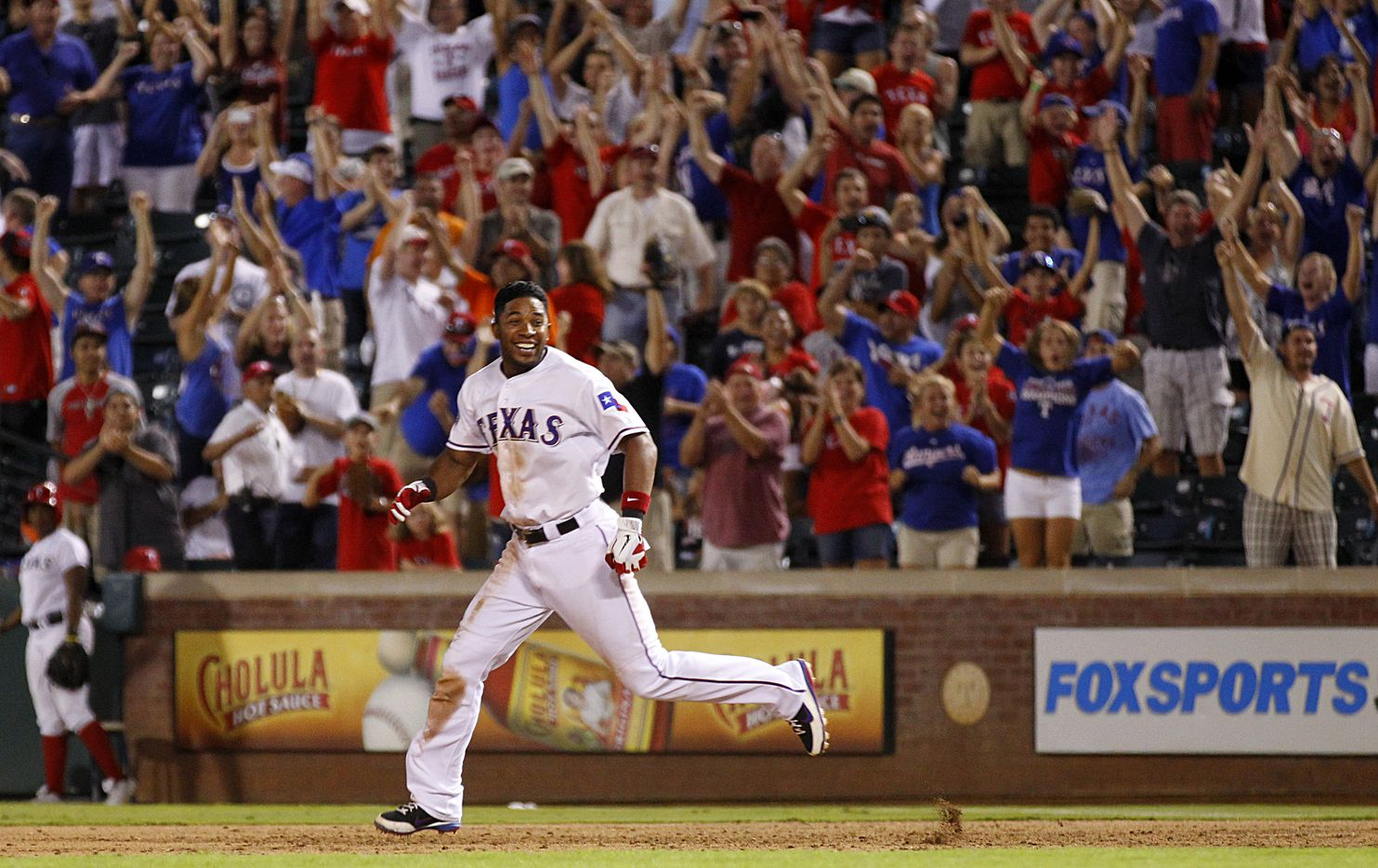 Texas Rangers Elvis Andrus celebrates his game winning hit, a two-run single, to win the game 11-10 in the bottom of the 10th inning against the Los Angeles Angels at the Rangers Ballpark in Arlington, Wednesday, August 1, 2012. (Tom Fox/The Dallas Morning News)