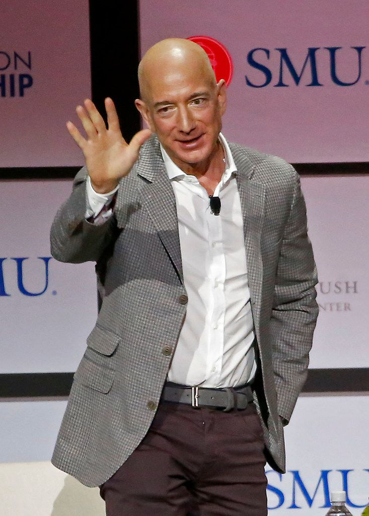 Jeff Bezos, chairman and CEO of Amazon, waved to the crowd after he spoke during a Closing Conversation with Jeff Bezos session, part of the George W. Bush Presidential Center's Forum on Leadership at Moody Coliseum in Dallas on April 20, 2018.