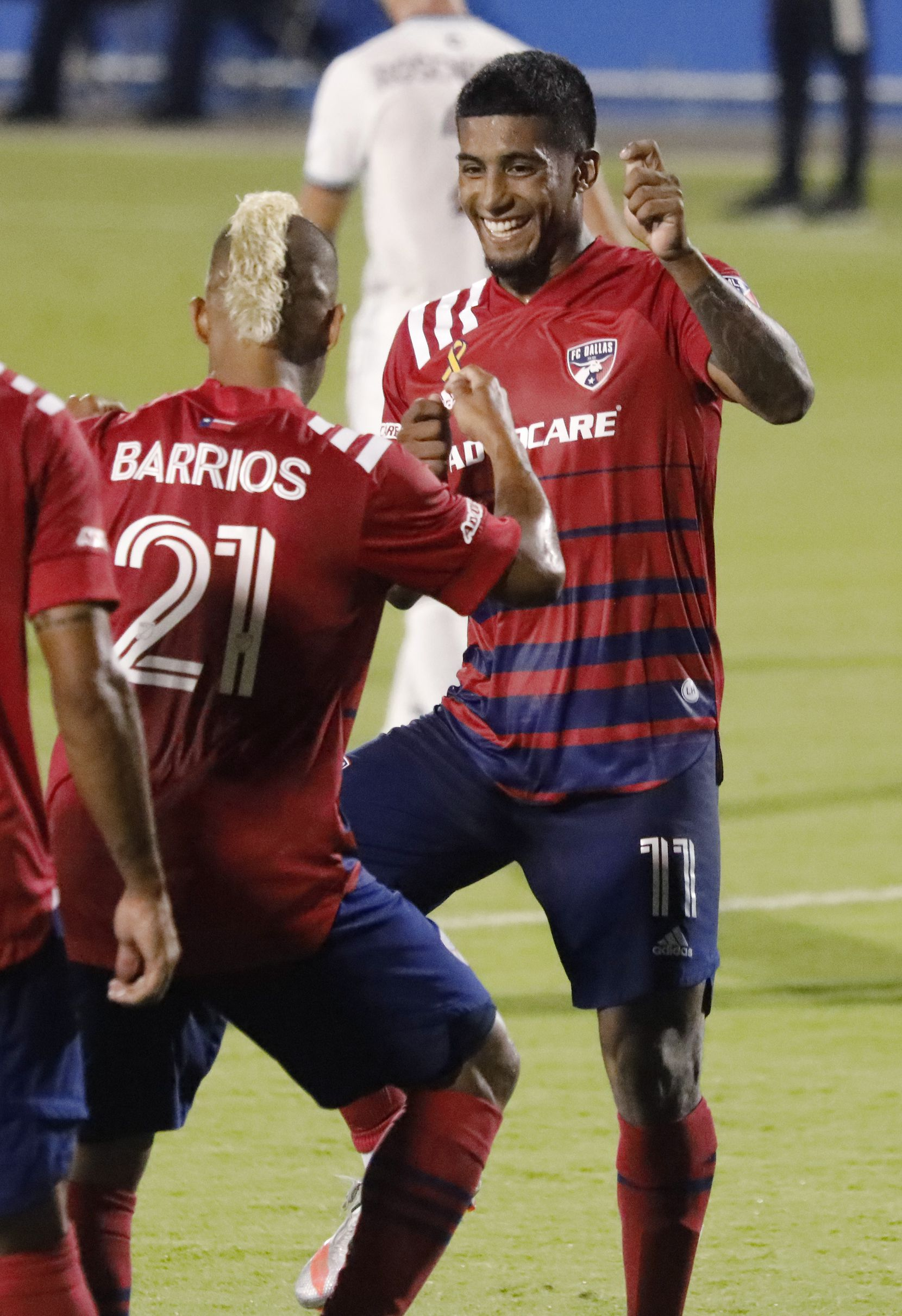 FC Dallas midfielder Santiago Mosquera (11) celebrates his first goal by dancing with FC Dallas midfielder Michael Barrios (21) during the first half as FC Dallas hosted the Colorado Rapids at Toyota Stadium in Frisco on Wednesday night, September 16, 2020. (Stewart F. House/Special Contributor)