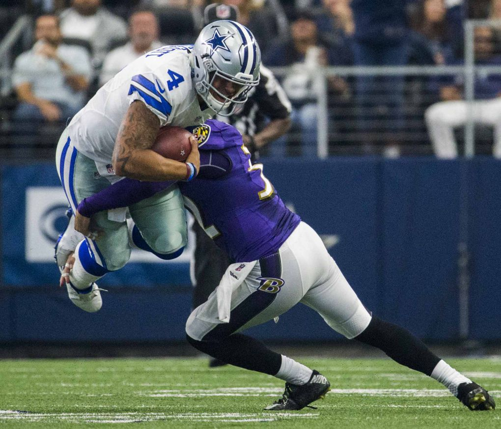 Dallas Cowboys quarterback Dak Prescott (4) is tackled by Baltimore Ravens strong safety Eric Weddle (32) during the second quarter of their game on Sunday, November 20, 2016 at AT&T Stadium in Arlington, Texas.