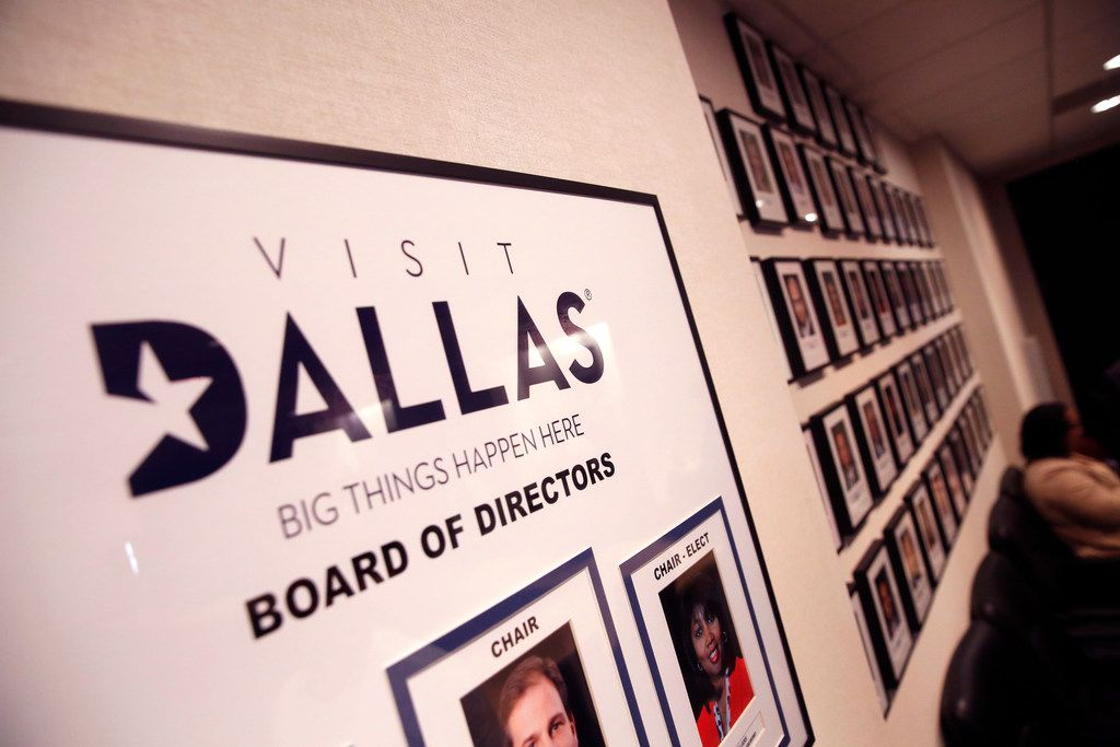 The VisitDallas board of directors and members on the wall at the VisitDallas office in Dallas on March 9, 2019. (Rose Baca/Staff Photographer)