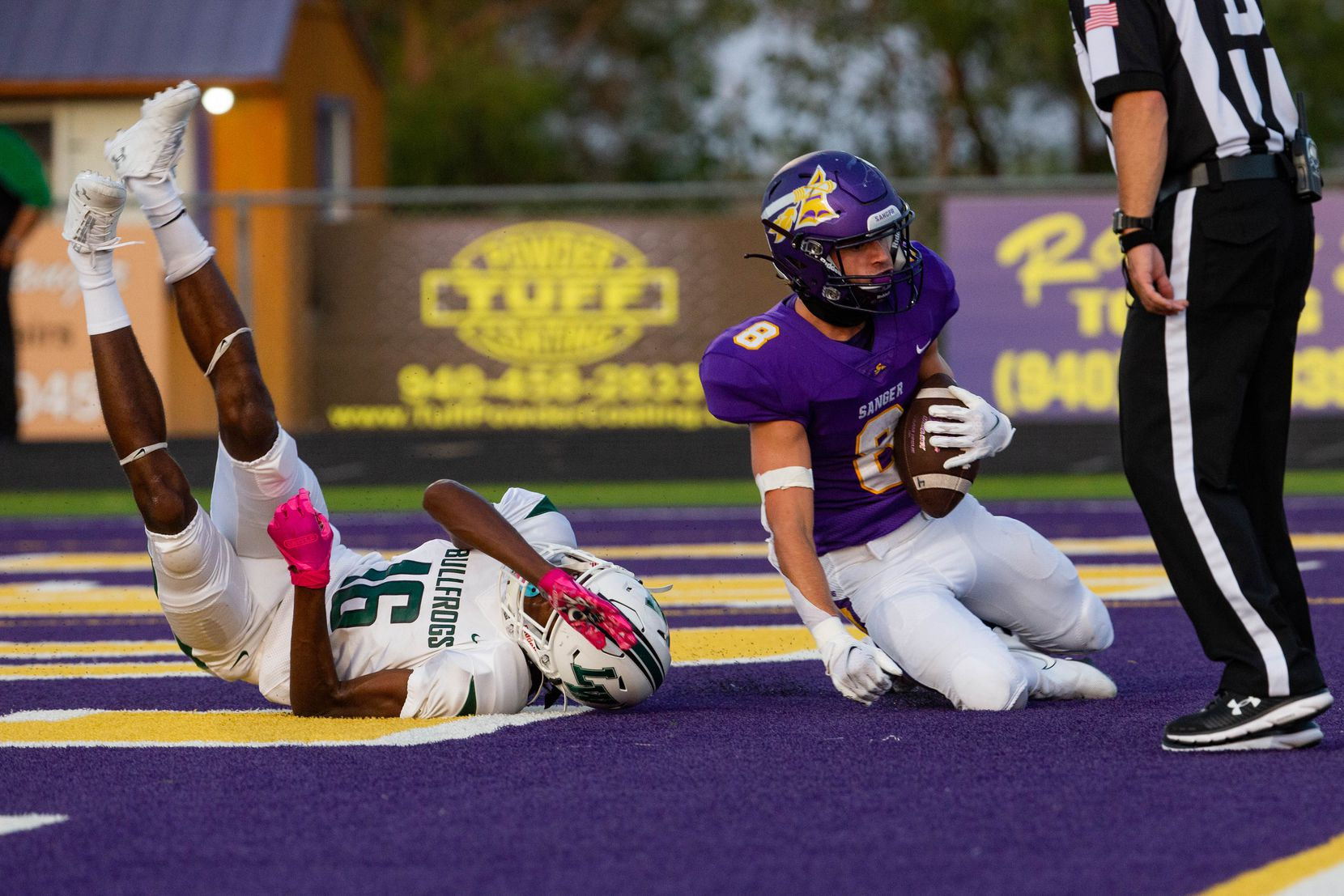 Sanger High School player Zach Shepard avoids being tackled by Lake Worth High School's Craig Williams for a touchdown during the first quarter of a game on Sept. 4, 2020 in Sanger.  Sanger leads 26-14 at halftime. (Juan Figueroa/ The Dallas Morning News)