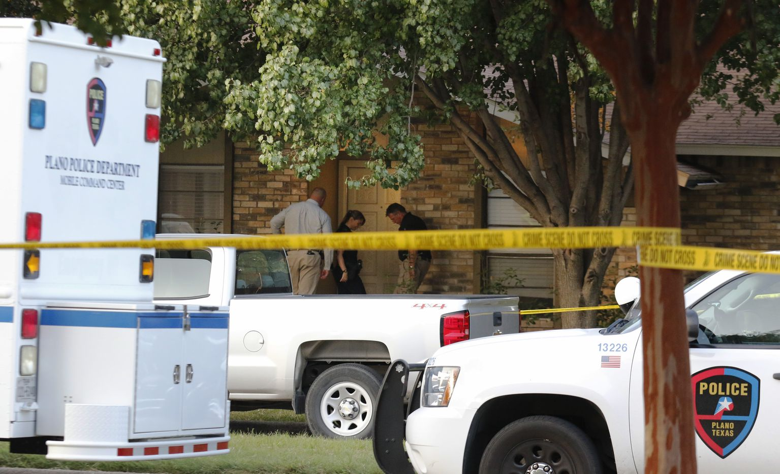 Plano police and the Texas Rangers work the scene of the shooting on Monday morning.