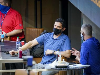 FILE - President of baseball operations Jon Daniels (center) watches an intrasquad game from a field-level suite during Rangers Summer Camp at Globe Life Field on Friday, July 17, 2020.