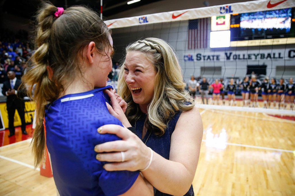 Trophy Club Byron NelsonÕs Paige Flickinger (8) and coach  Brianne Groth celebrate after winning the class 6A volleyball state final match against Plano West at the Curtis Culwell Center in Garland, on Saturday, November 23, 2019. Nelson won the fifth set 15-7 to become the title champions. (Juan Figueroa/The Dallas Morning News)