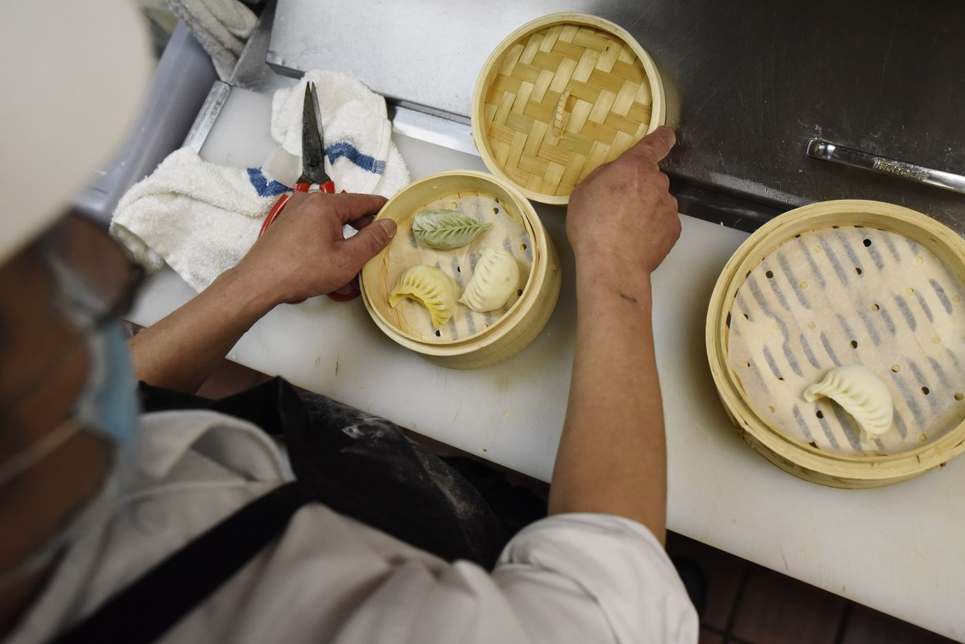 Dumpling chef Harrison Huang prepares a combo of dumplings containing veggie, chicken and pork/shrimp, at Kitchen Master restaurant in Frisco, Sunday, May 31, 2020.