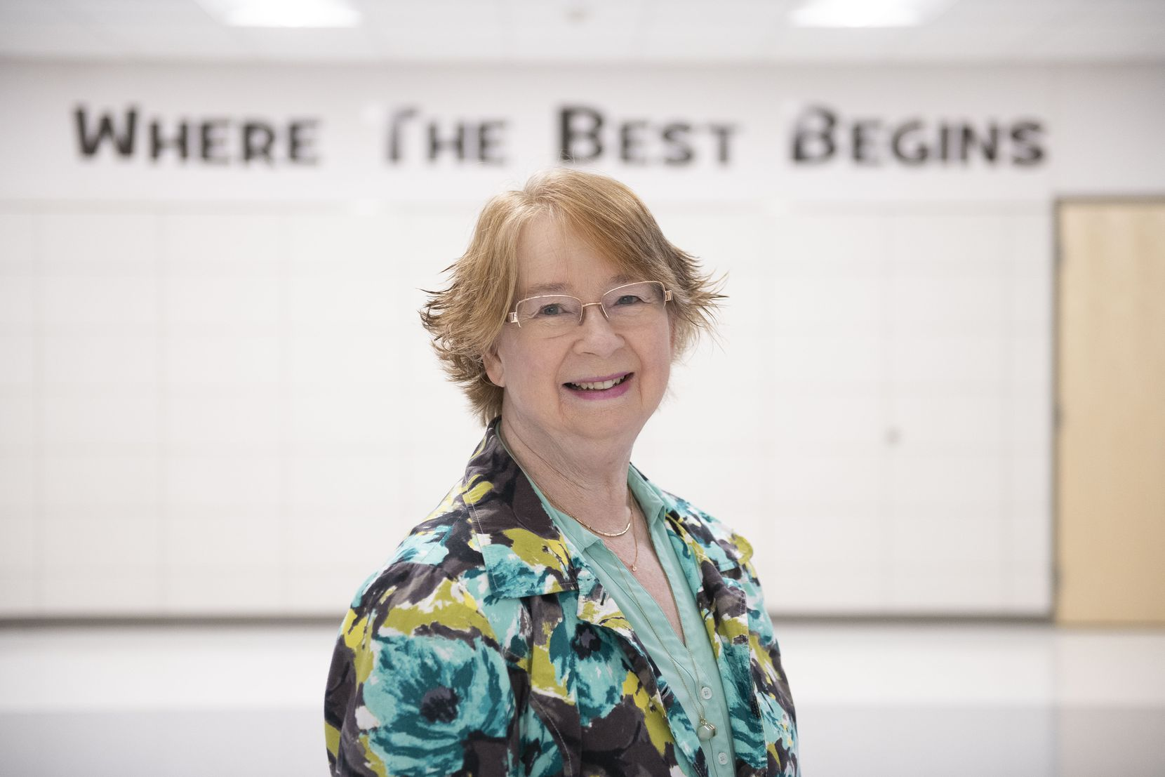 Louise Weaver, who is retiring this year after a 50-year career as an educator in Mesquite, stands in front of Rutherford Elementary School, her final stop after teaching in several Mesquite ISD schools.