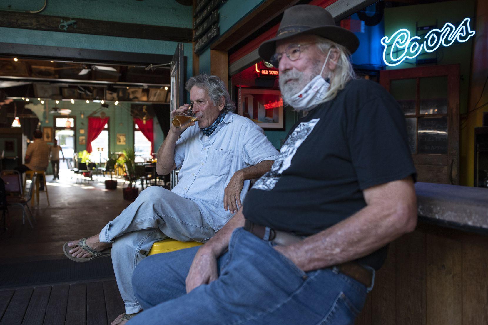 Dan's Silverleaf co-owner Dan Mojica (left) had a beer with John Snow on the bar's patio.