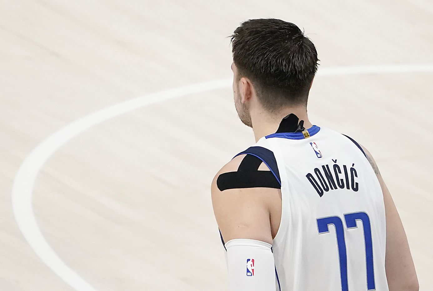 Dallas Mavericks guard Luka Doncic (77) wears tape on his shoulder and neck during the fourth quarter of an NBA playoff basketball game against the LA Clippers at American Airlines Center on Sunday, May 30, 2021, in Dallas.  The Clippers won the game 106-81.