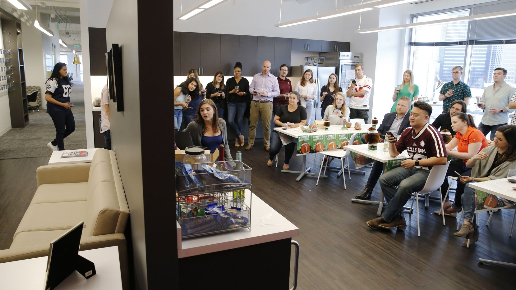 Employees took a football quiz during a Fantasy Football Draft Fun Friday Happy Hour at West Monroe Partners in Dallas in August.
