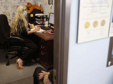 Sheila Baker, LCDC (licensed chemical dependency counselor) talks with a patient at the Anti-Aging and Longevity Medical Center in Dallas on Thursday, August 7, 2020. The center is a local addiction treatment center that has stayed open during the COVID-19 pandemic to provide patients with access to medications that treat opioid addiction. (Vernon Bryant/The Dallas Morning News)