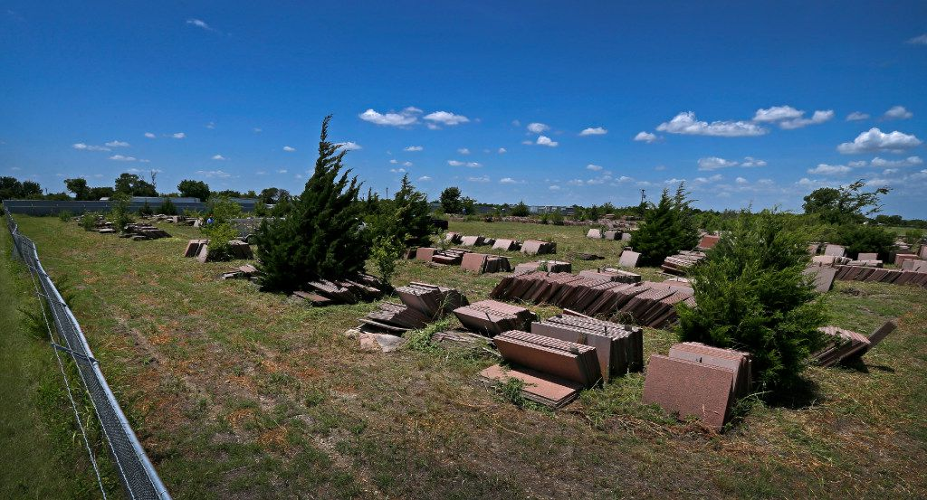 A pile of granite sits in a storage yard  in Ferris. Almost 30 years after plans for a second Cityplace skyscraper fell through, all the cut granite to build the 42-story tower is still lying in this field south of Dallas.  (Jae S. Lee/Staff Photographer)