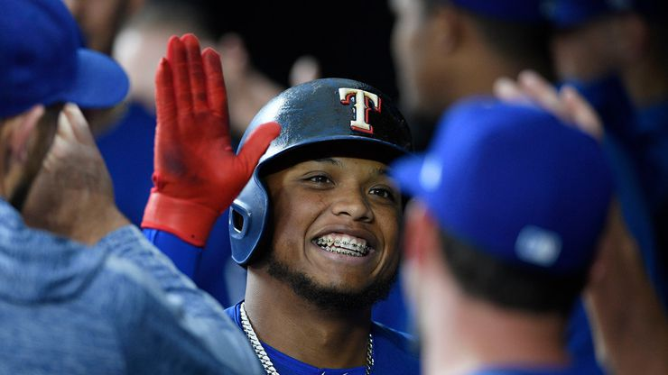 Texas Rangers' Willie Calhoun celebrates his home run in the dugout during the first inning of a baseball game against the Baltimore Orioles, Friday, Sept. 6, 2019, in Baltimore. (AP Photo/Nick Wass)