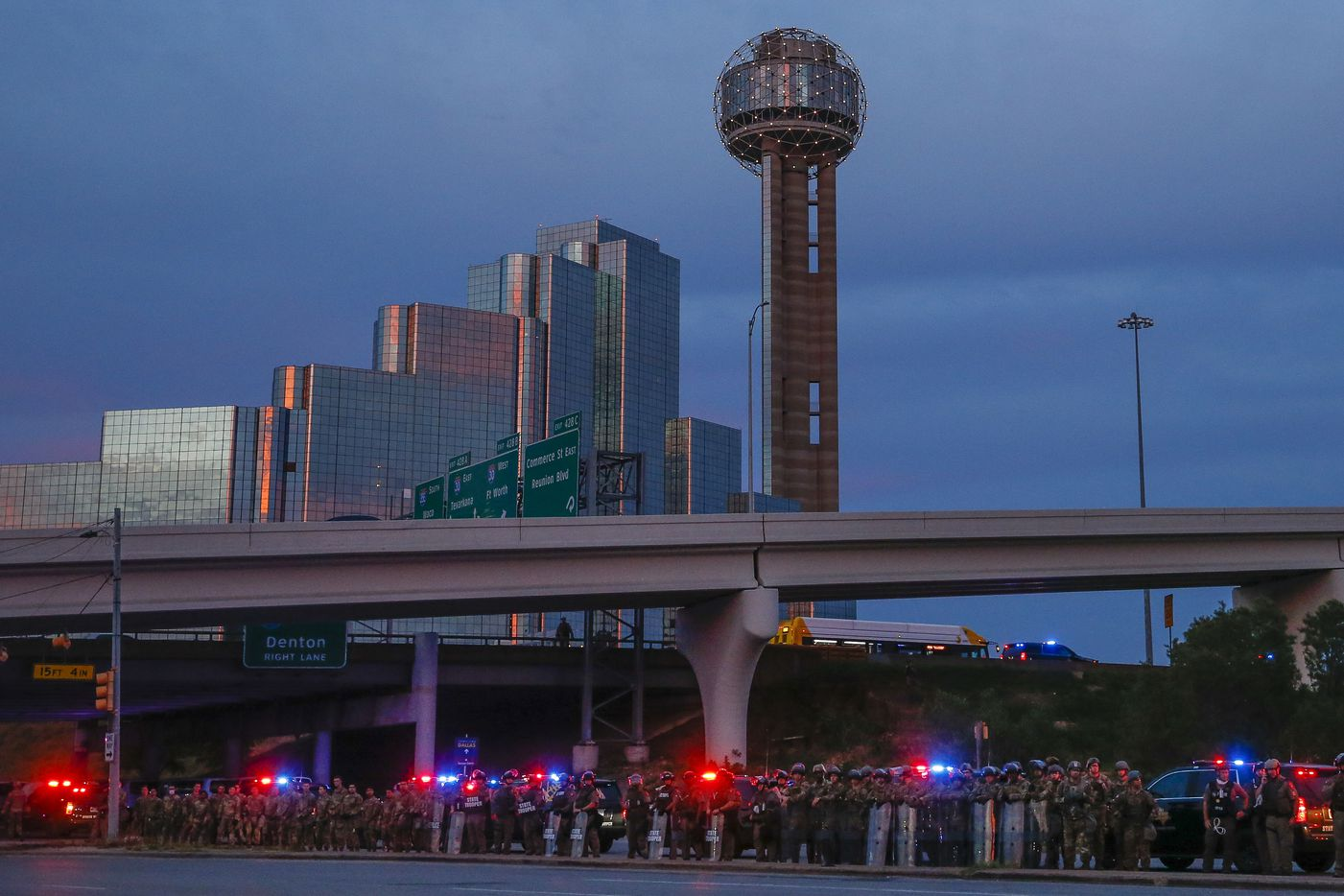Police and the National Guard stage as protesters prepare to march to the Margaret Hunt Hill Bridge as they demonstrate against police brutality on Monday, June 1, 2020, in Dallas. Later on, the hundreds of protesters were surrounded and detained by police on the bridge.