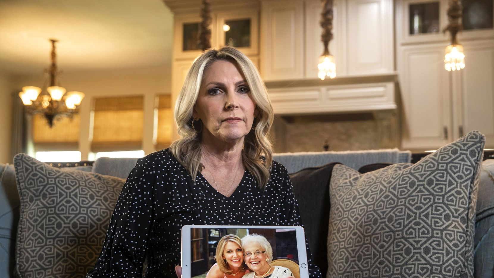 Cheryl Pangburn holds a photo of her and her mother, Marilyn Bixler — taken at luxury senior living community Parkview in Frisco — at Pangburn's home in Frisco.